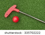 red mini golf putter and ball...