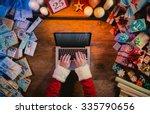 Santa Working At Desk And...