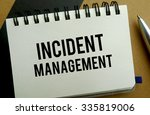 Incident management memo written on a notebook with pen - stock photo