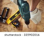 building master with drilling... | Shutterstock . vector #335902016
