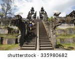 bali temple with people walking ... | Shutterstock . vector #335980682