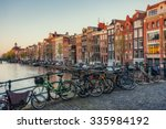 Stock photo beautiful tranquil scene of the city of amsterdam bicycles along the street on the bridge over the 335984192
