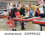 Small photo of ENSCHEDE, THE NETHERLANDS - OCT 15, 2015: A couple is paying het products they just bought in the Dirk supermarket at the cashier.