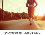 woman's legs running outdoors... | Shutterstock . vector #336014312