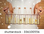 snow against woman holding... | Shutterstock . vector #336100556