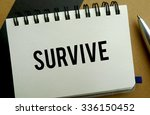 Survive memo written on a notebook with pen - stock photo