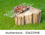 Meet barbecue on silver plate - stock photo