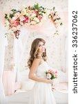 beautiful bride in long dress... | Shutterstock . vector #336237062