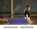 beautiful girl does exercise on ...   Shutterstock . vector #336296246