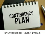 Contingency plan memo written on a notebook with pen - stock photo