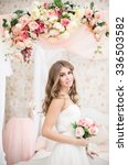 beautiful bride in long dress... | Shutterstock . vector #336503582