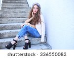 fashion model with long curly... | Shutterstock . vector #336550082