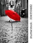 red umbrella on cobblestone... | Shutterstock . vector #336553682