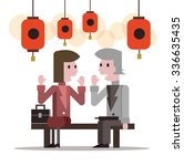 two business people talking at... | Shutterstock .eps vector #336635435