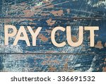 Small photo of Pay cut written with wooden letters on rustic surface