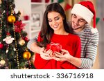 merry christmas. young couple... | Shutterstock . vector #336716918