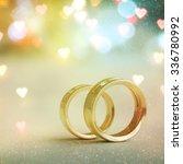 two golden wedding rings | Shutterstock . vector #336780992