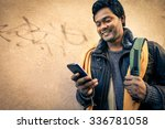 young indian man holding mobile ... | Shutterstock . vector #336781058