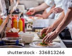 Male Cooks Preparing Meals In...