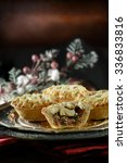 Small photo of Thanksgiving or Christmas festive lattice pastry mince pies on antique pewter plate against a rustic background with accommodation for copy space.