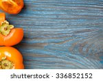 ripe juicy persimmons on blue... | Shutterstock . vector #336852152