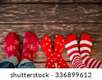 Feet Wearing Christmas Socks O...