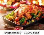 roasted turkey garnished with... | Shutterstock . vector #336935555