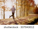 man running in park at autumn... | Shutterstock . vector #337043012
