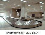 Baggage carousel at the airport - stock photo