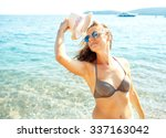 beach vacation. young woman in... | Shutterstock . vector #337163042