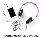 headphones and smartphone.... | Shutterstock . vector #337198382
