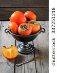 persimmon in a metal vase on a... | Shutterstock . vector #337251218