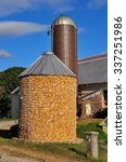 Small photo of Lancaster County, Pennsylvania - October 17, 2015: Silo and corn crib filled with dried corn for feeding livestock in winter at an Amish farm *