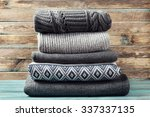 pile of knitted winter clothes... | Shutterstock . vector #337337135