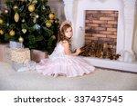 little girl near christmas... | Shutterstock . vector #337437545
