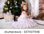 girl in a beautiful dress plays ... | Shutterstock . vector #337437548