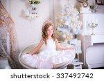 beautiful girl sitting on a big ... | Shutterstock . vector #337492742