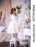beautiful girl decorates a... | Shutterstock . vector #337494866