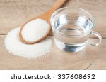 wooden spoon sugar and glass of ... | Shutterstock . vector #337608692