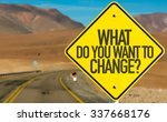 Small photo of What Do You Want to Change? sign on desert road