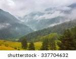 cloudy day in mountain valley | Shutterstock . vector #337704632