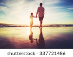 father and son holding hands... | Shutterstock . vector #337721486