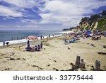 Bright Umbrellas Dot The Beach...