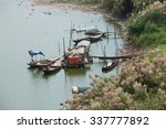 Small photo of Poor floating village, slumdog are on the bank of Red river, only 2km from the center of Hanoi capital.