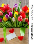 tulips in the box on wooden... | Shutterstock . vector #337780712