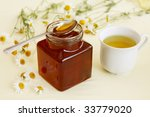 Chamomile tea and honey - stock photo