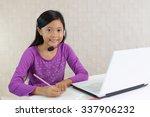 girl using laptop | Shutterstock . vector #337906232