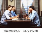 young men talking in cafe | Shutterstock . vector #337914728
