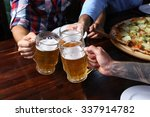 male hands holding glasses with ... | Shutterstock . vector #337914782