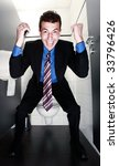 happy businessman with tie standing in restroom - stock photo